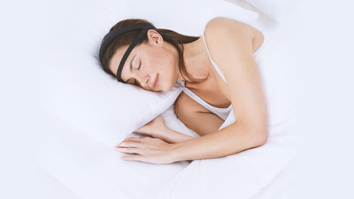 Woman sleeping with a Dreem 2 Headband