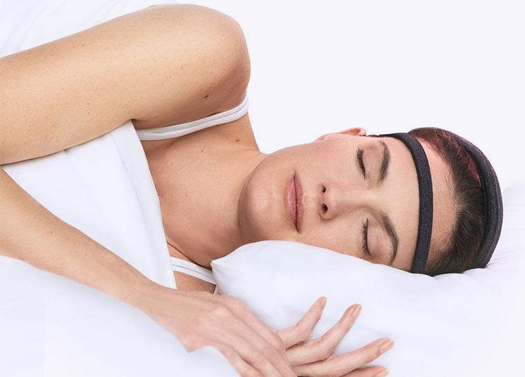 Woman Sleeping with Dreem headband