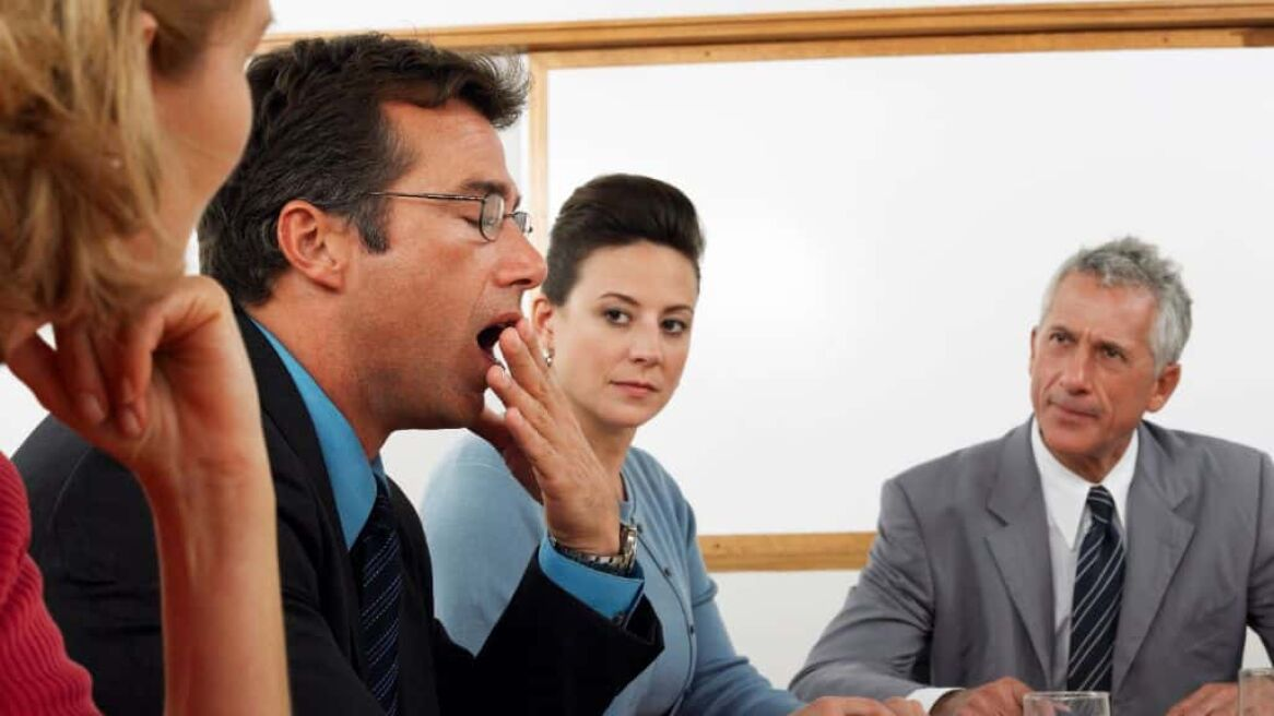Businessman yawning  at business meeting