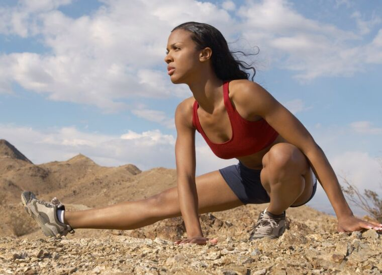 Female Jogger stretching