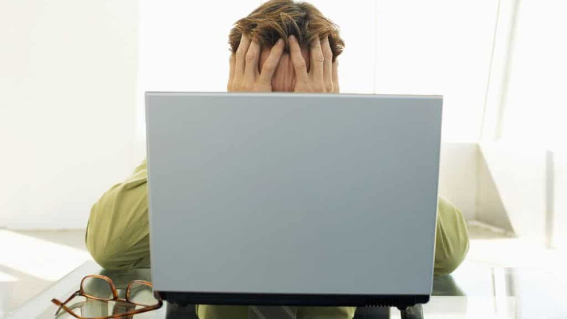 Stressed Man in front of Laptop