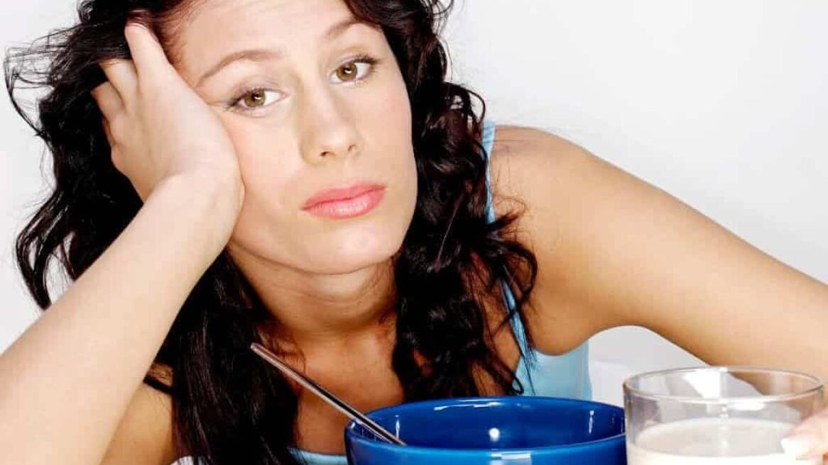 Tired Woman eating breakfast