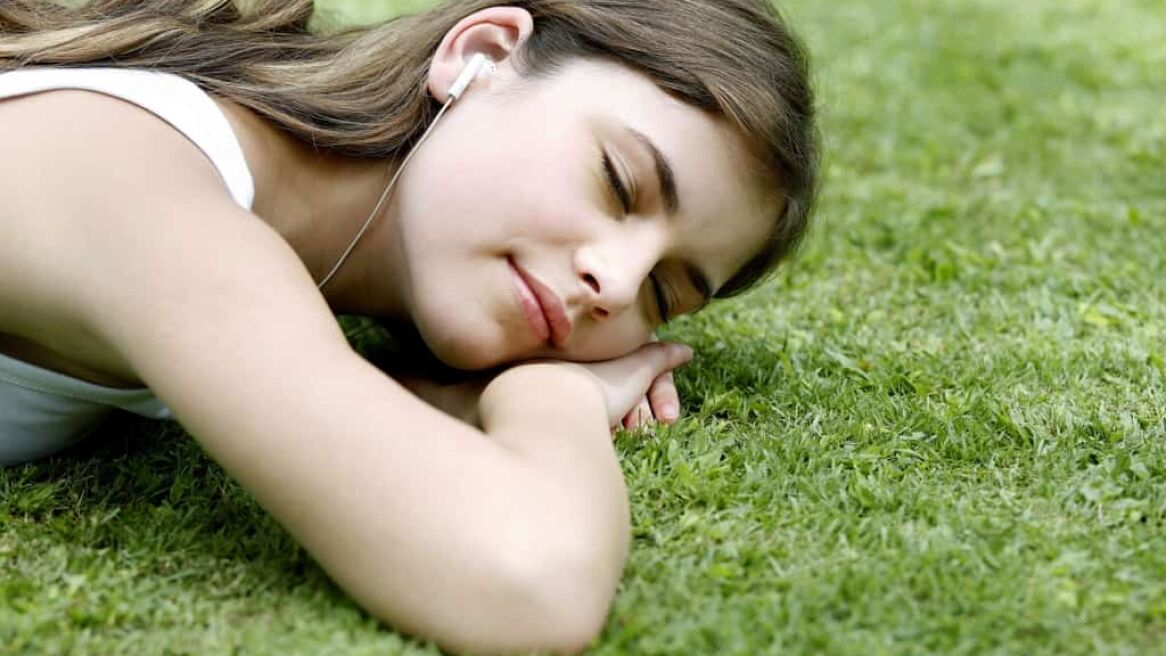 Woman lying forward on the grass
