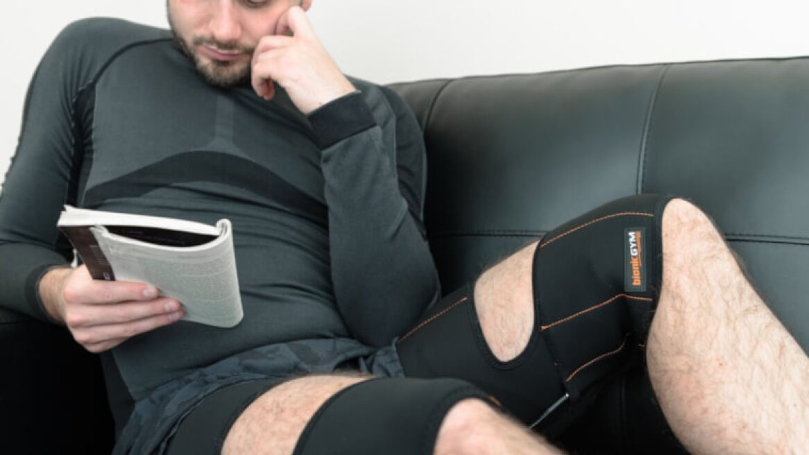 Man wearing Bionic Gym on couch